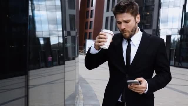 Businessman Drinks Coffee: Stock Video