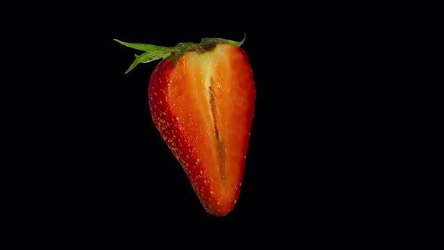 Isolated Strawberry Slice: Stock Video
