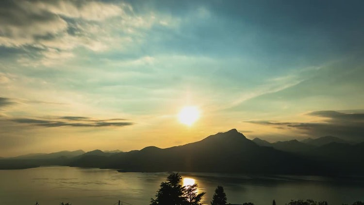 Lake Sunrise With Mountain And Clouds: Stock Video
