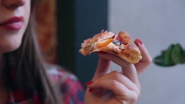 Woman Eating Pizza: Stock Video