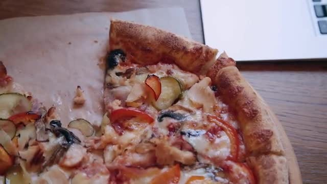 Pizza Next To A Laptop: Stock Video