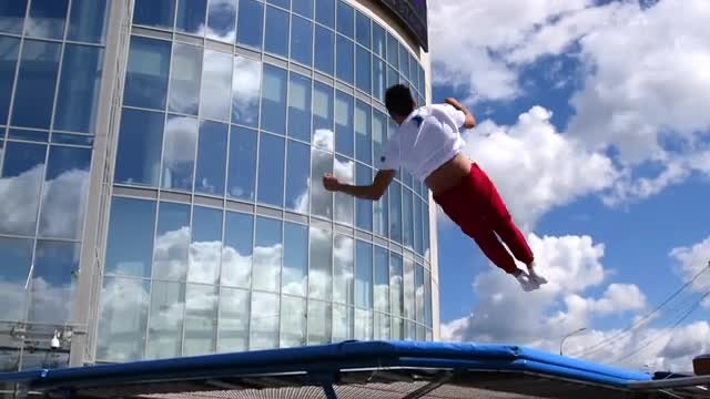 Jumping On Trampoline: Stock Video