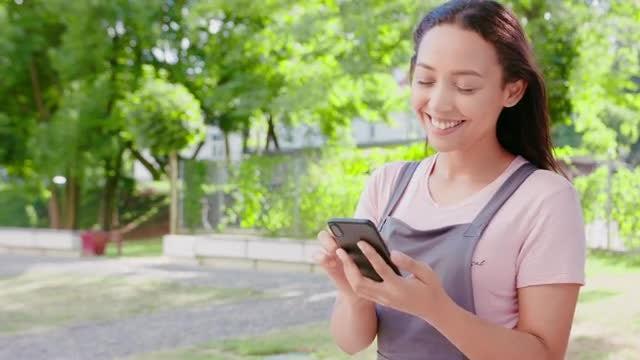 Girl Using Phone: Stock Video