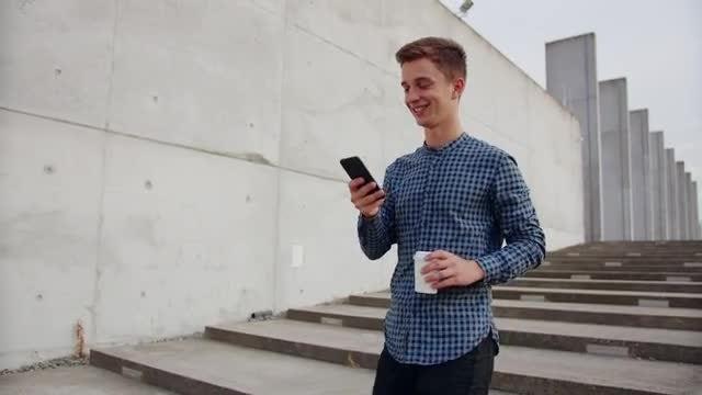 Checking Phone On Walk: Stock Video