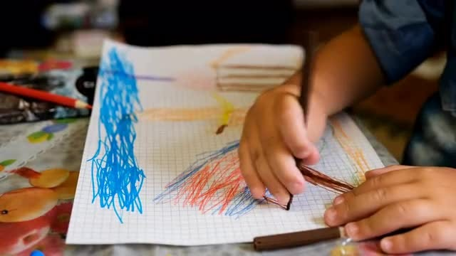 Young Child Drawing: Stock Video