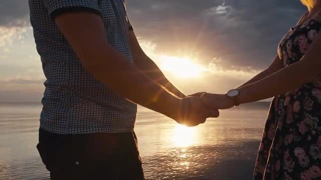 Holding Hands At Sunset: Stock Video