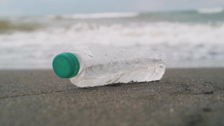 Plastic Bottle On Beach: Stock Video