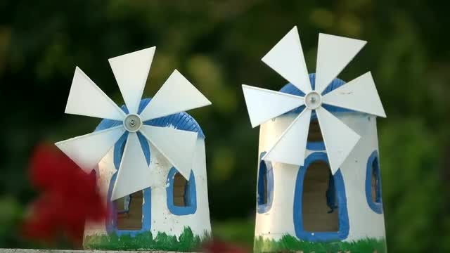 Two Lawn Windmills: Stock Video