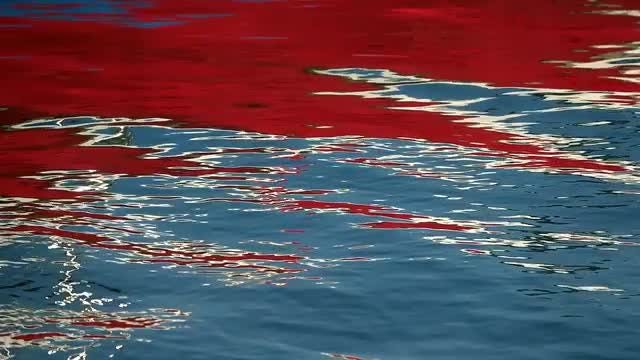 Red Reflection On The Water: Stock Video