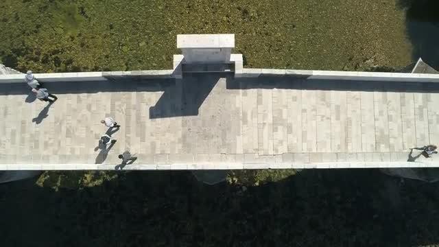 Walking Across Old Bridge: Stock Video