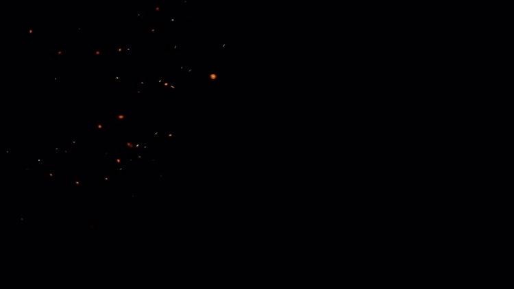 Sparks on black background: Stock Video