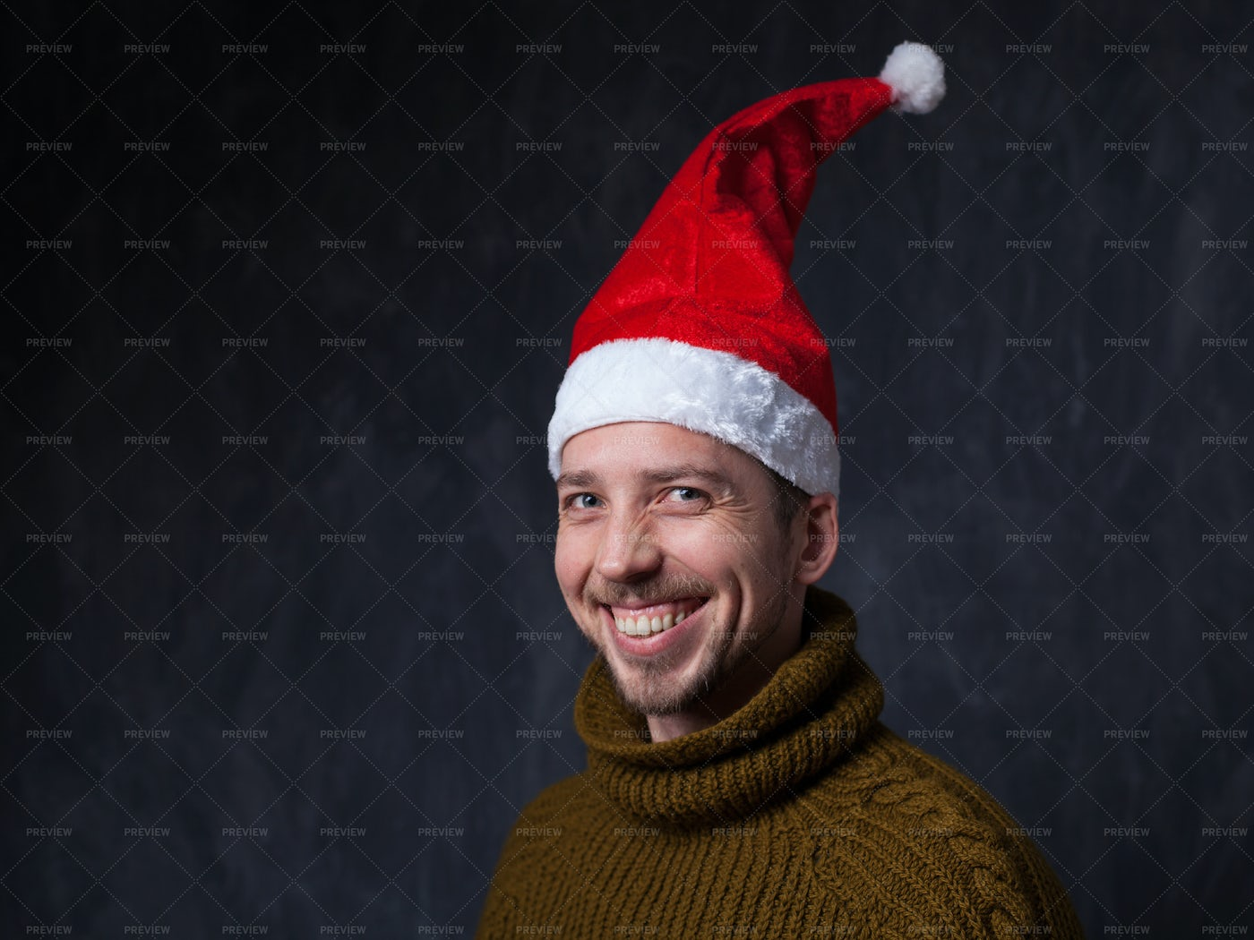 Man Smiling In Red Christmas Cap: Stock Photos