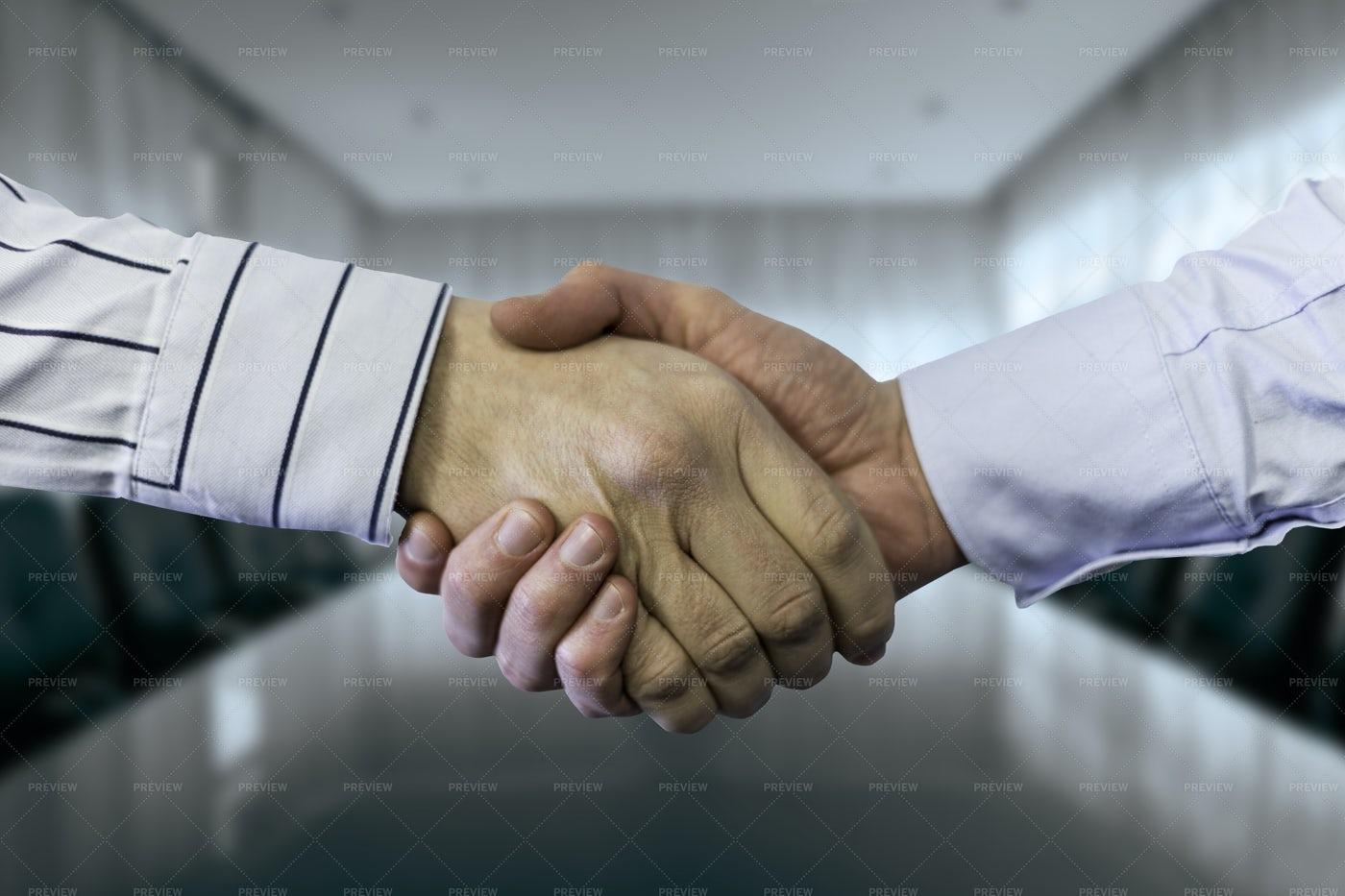Businessmen Shake In Agreement: Stock Photos