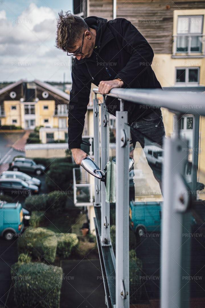 Man Cleans Balcony: Stock Photos