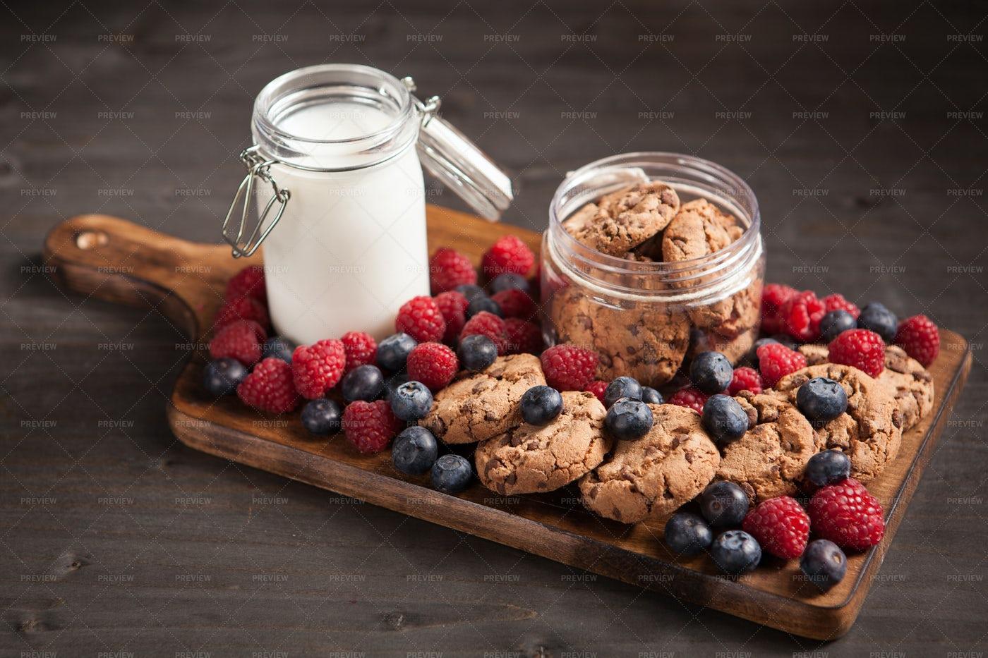 Milk Next To Chocolate Chip Cookies: Stock Photos