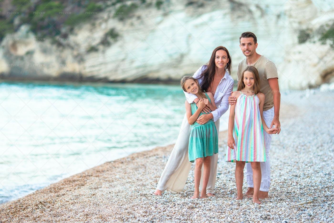 Happy Family On White Beach: Stock Photos