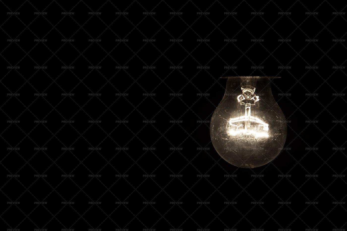 Vintage Light Bulb Glowing In Dark: Stock Photos