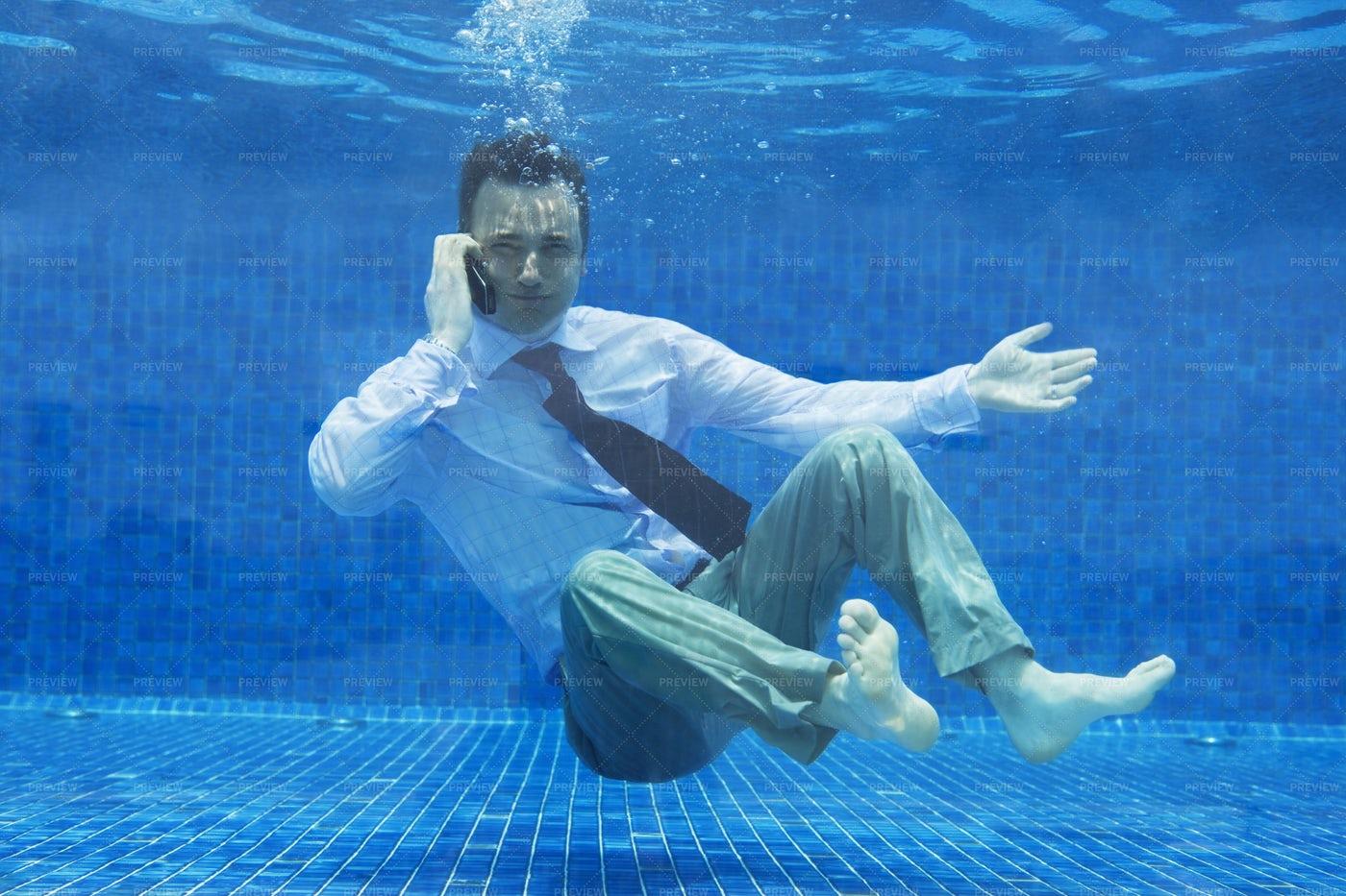Businessman Underwater: Stock Photos