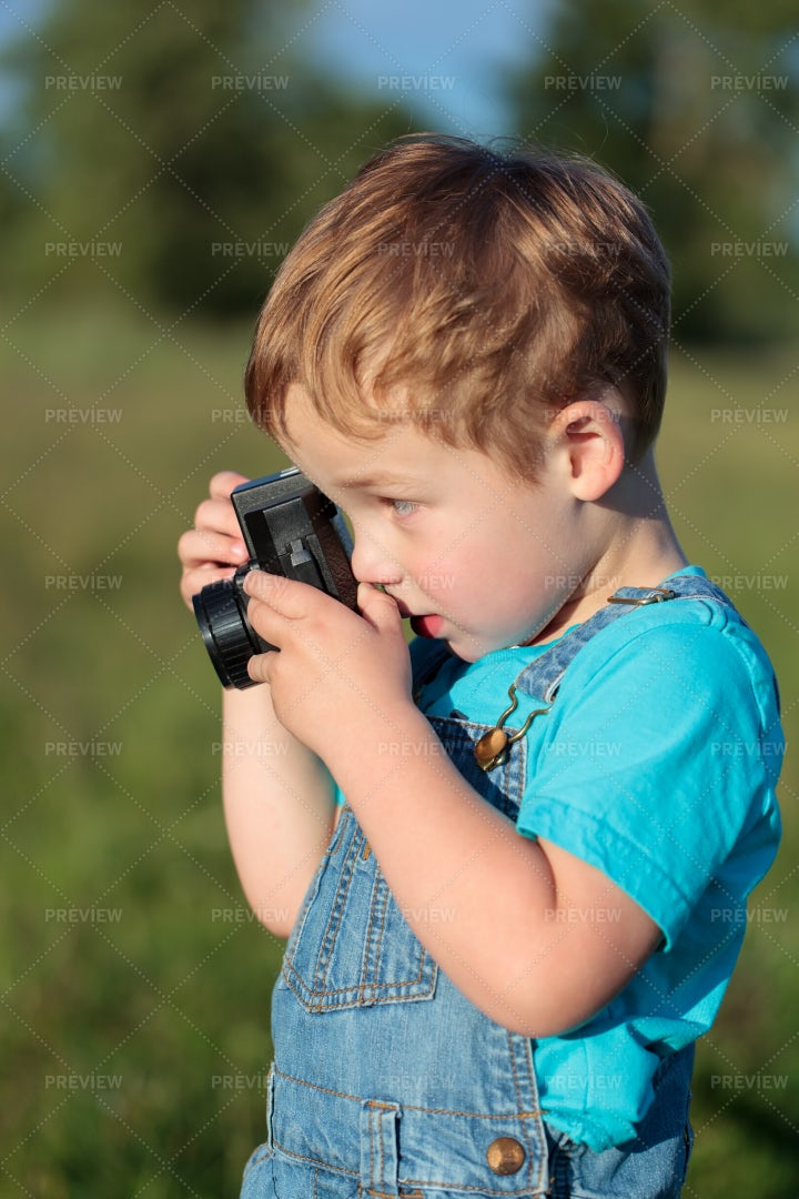 Little Boy Taking Pictures: Stock Photos