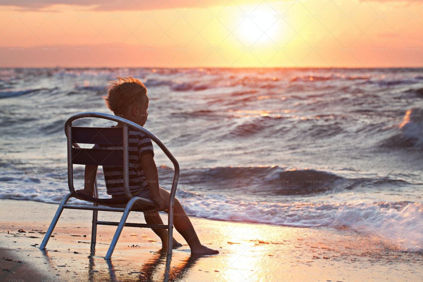Boy Watching Beach Sunset: Stock Photos