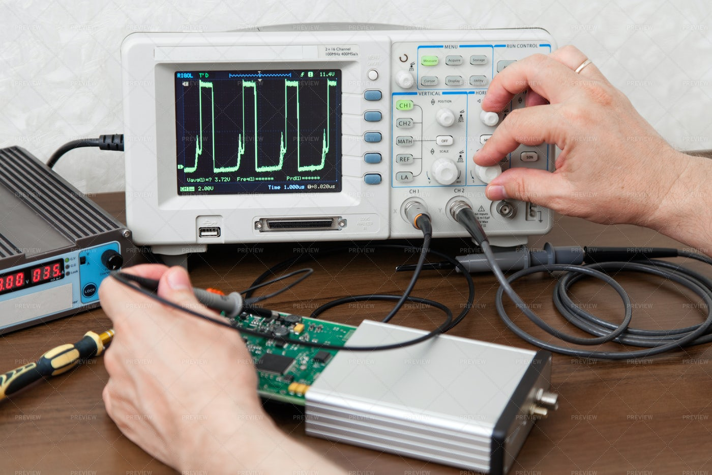 Engineer Measuring Signals: Stock Photos