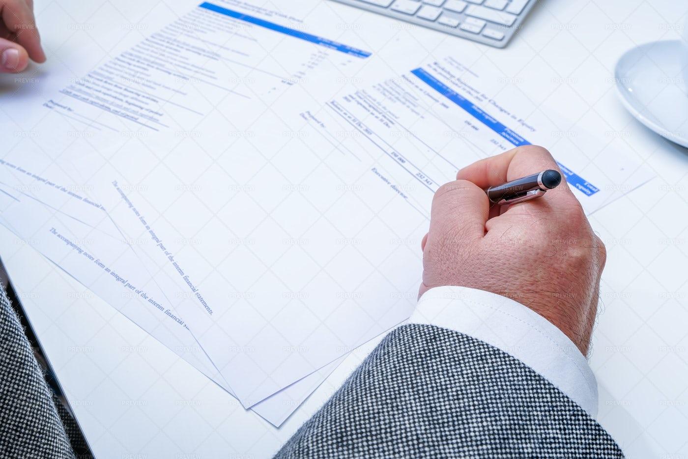 Businessman Reviews Paperwork: Stock Photos