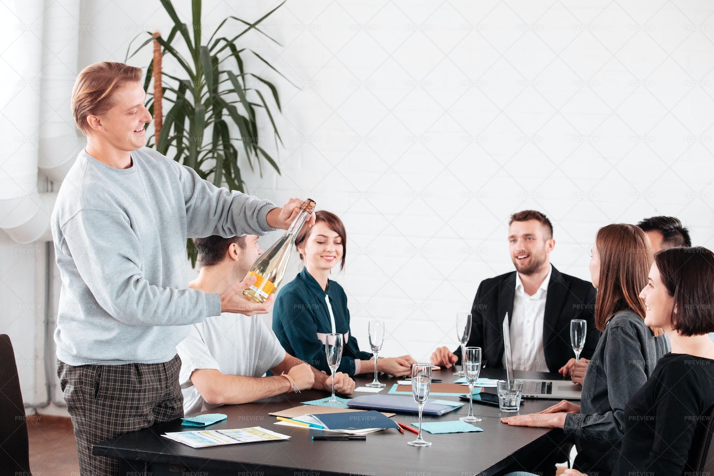 Champagne In Office Celebration: Stock Photos