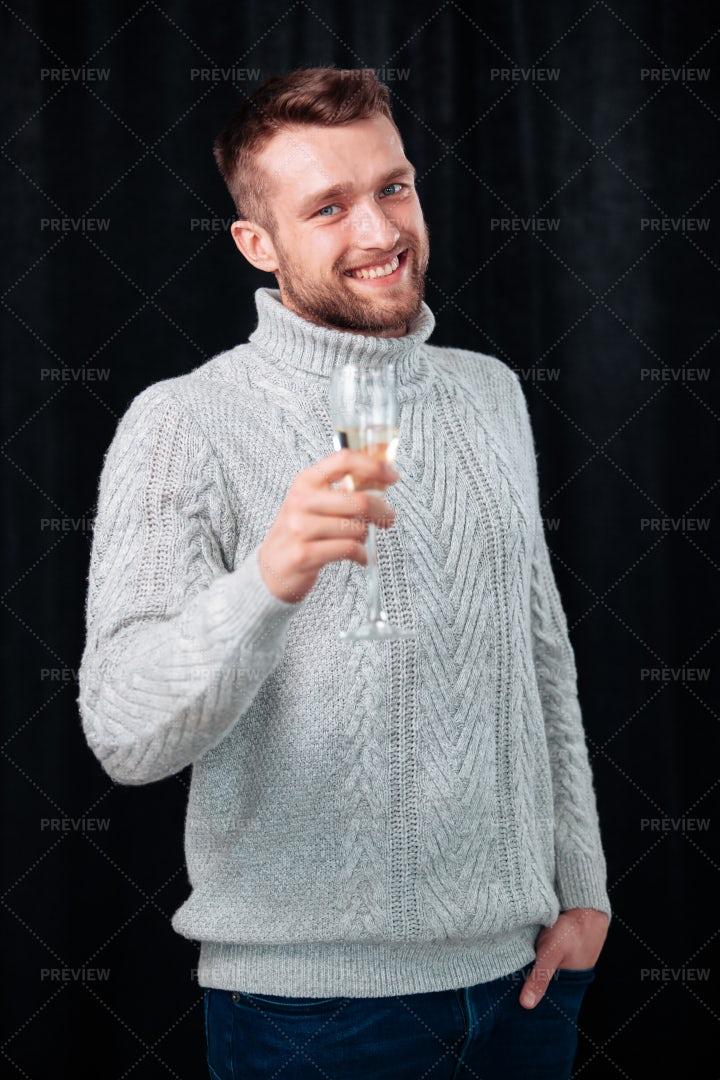 Portrait Of A Man Toasting: Stock Photos