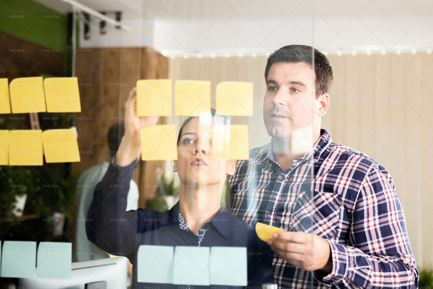 Assessing Sticky Note Ideas: Stock Photos