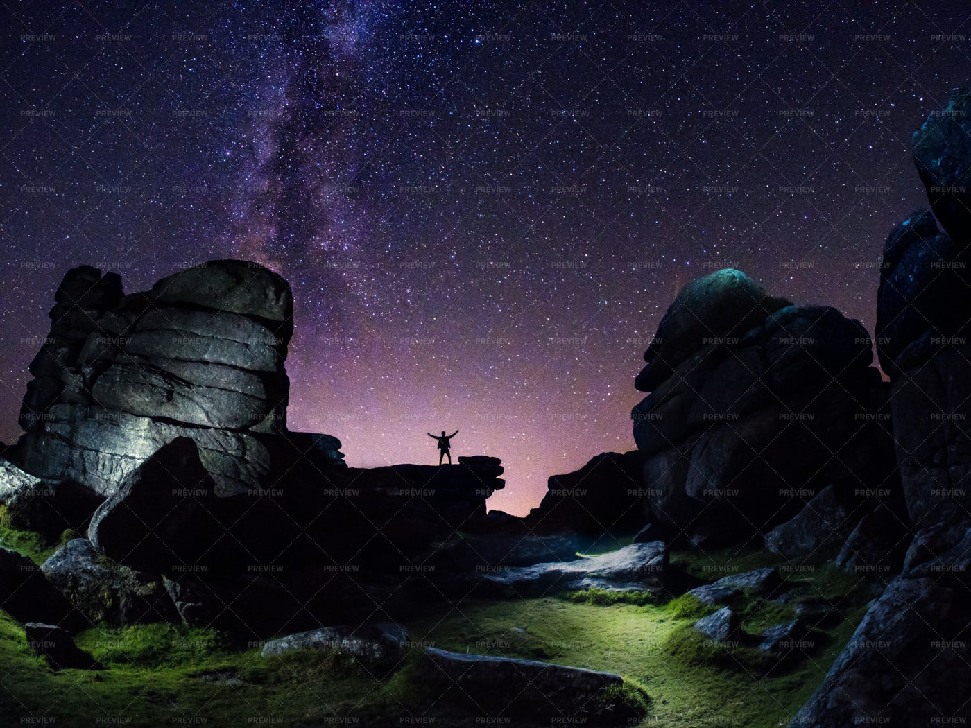 A Figure On Rocks At Night: Stock Photos