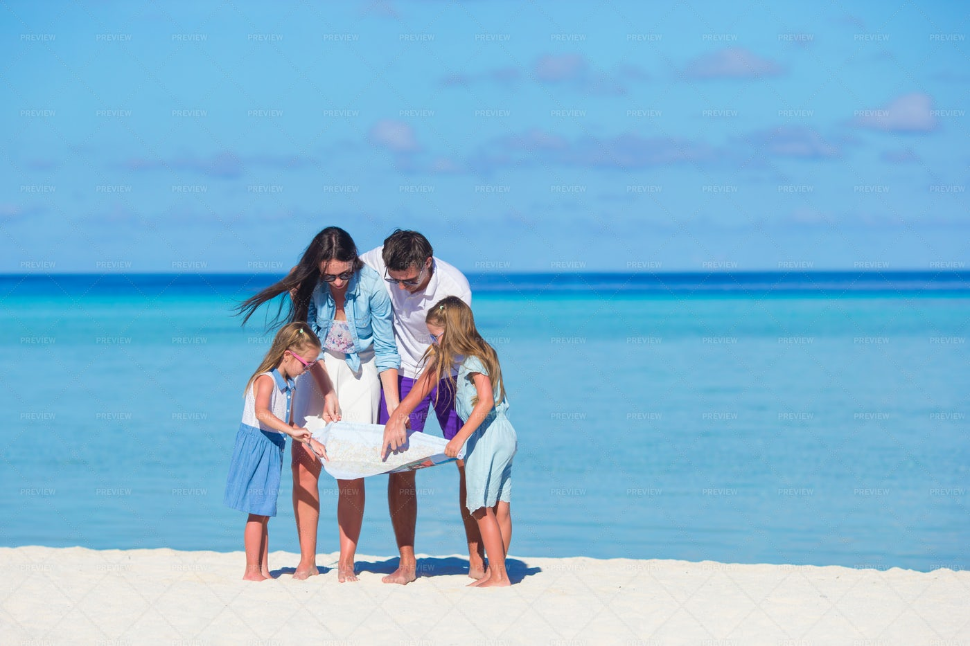 Family Viewing A Map: Stock Photos
