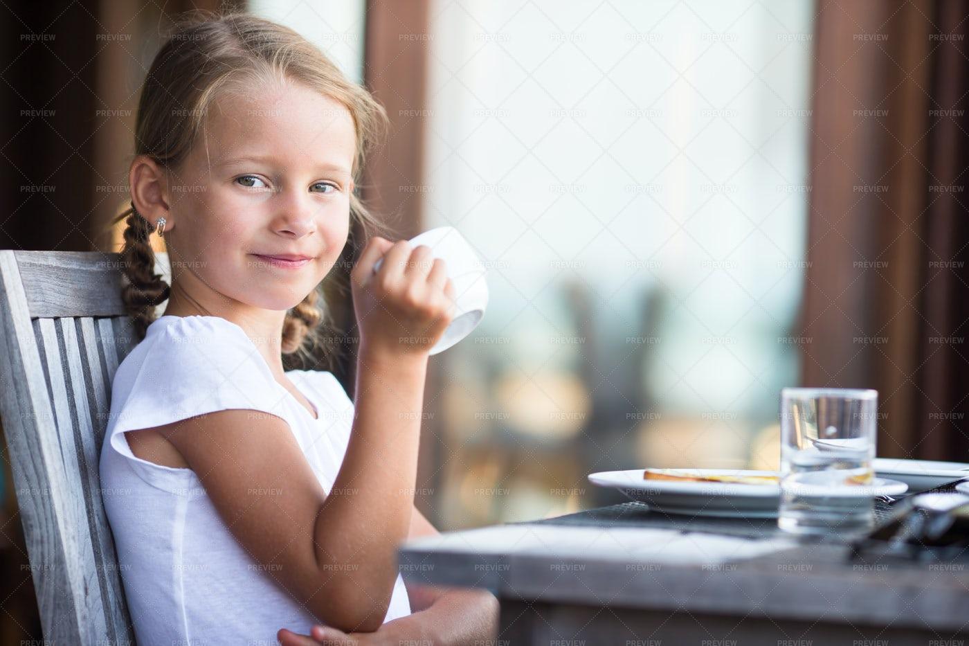Little Girl Drinking Tea: Stock Photos