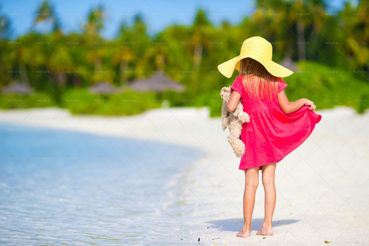 Little Girl In A Hat At The Beach: Stock Photos