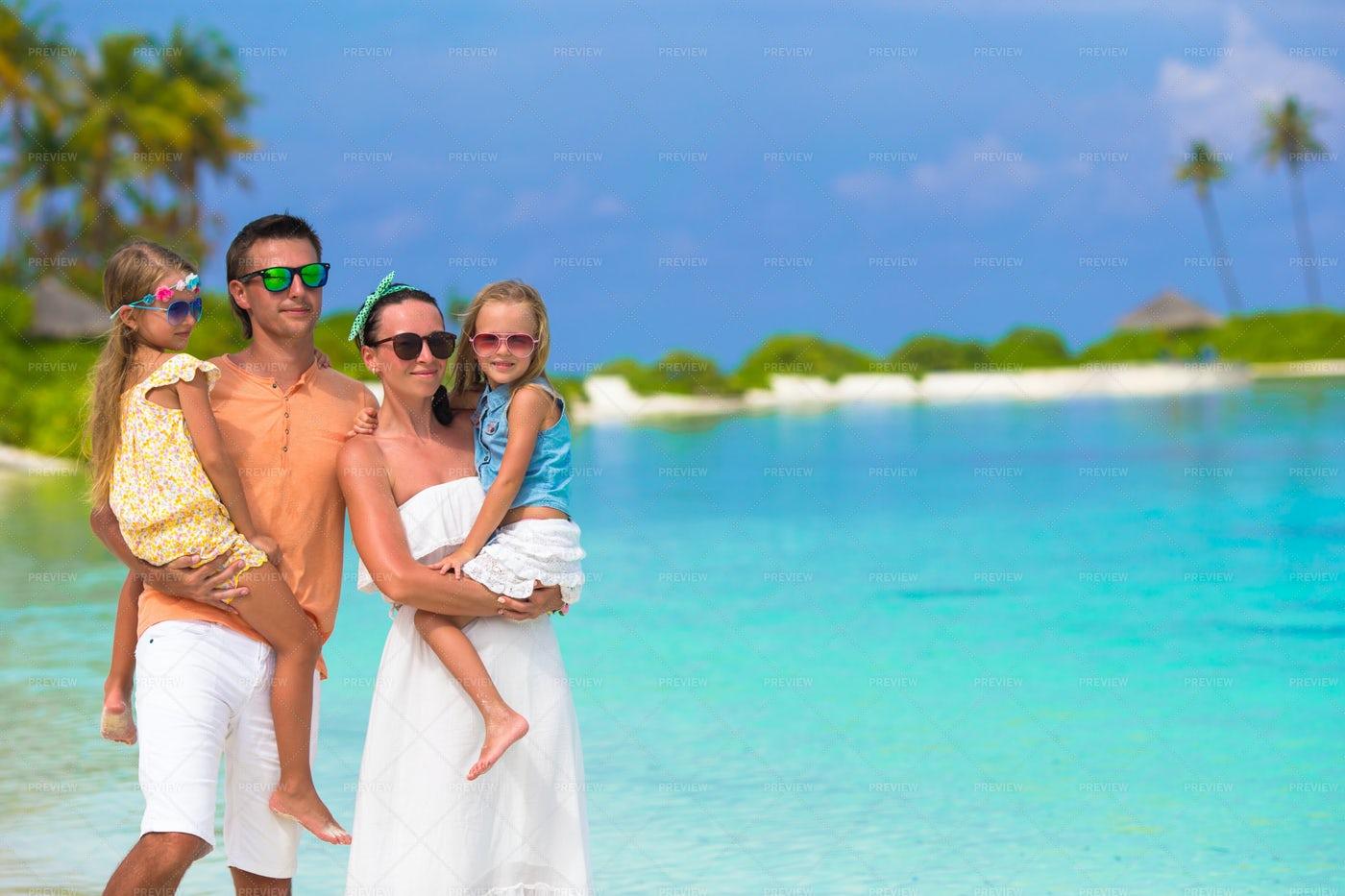 Family Of Four On Beach Vacation: Stock Photos