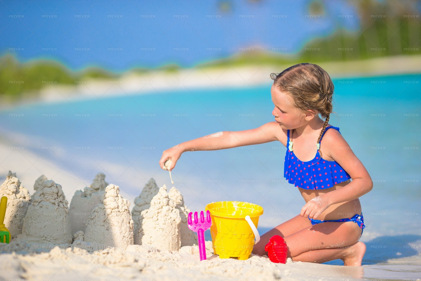 Little Girl Playing In The Sand: Stock Photos