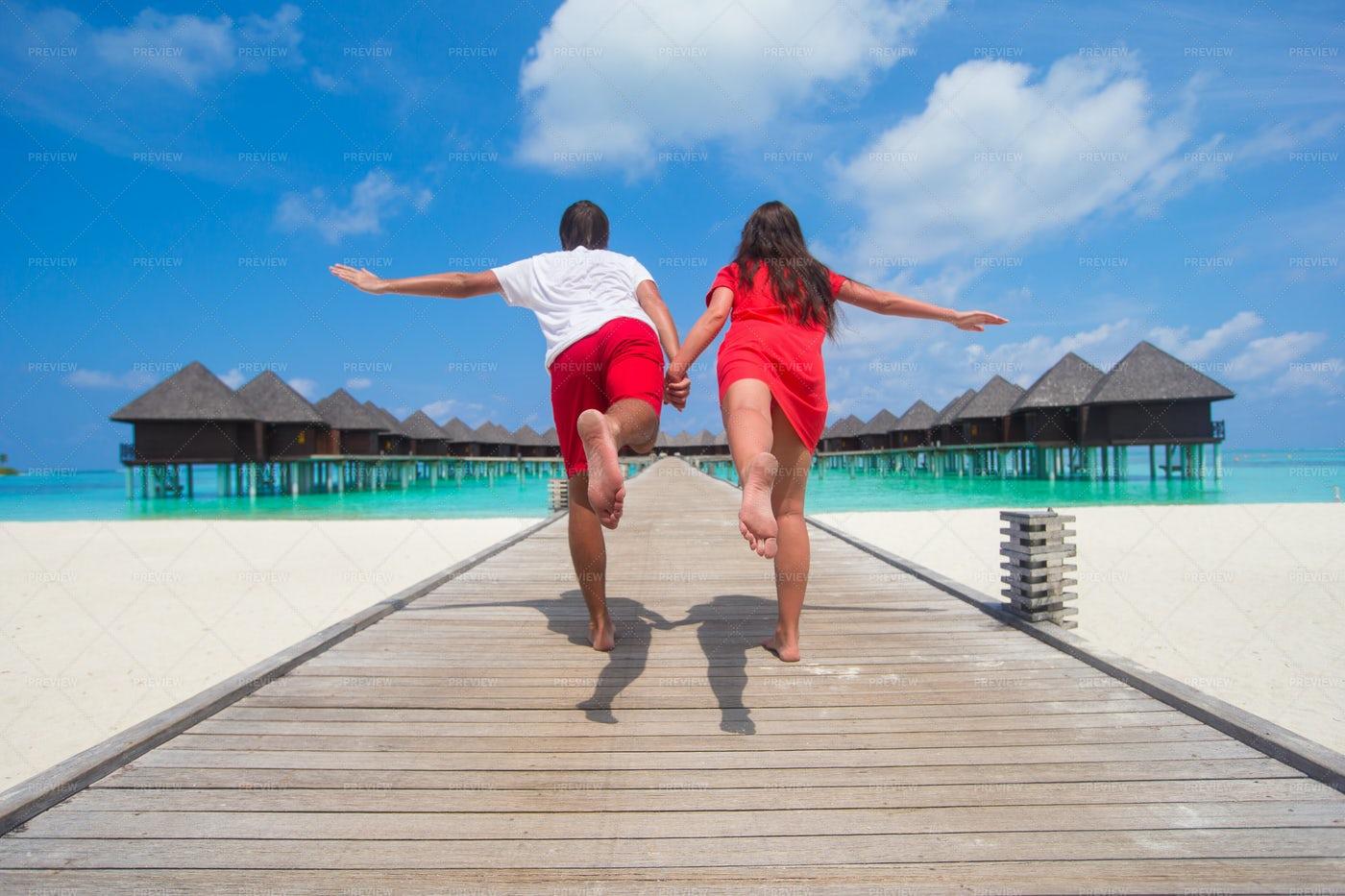 Couple Enjoying A Tropical Beach: Stock Photos