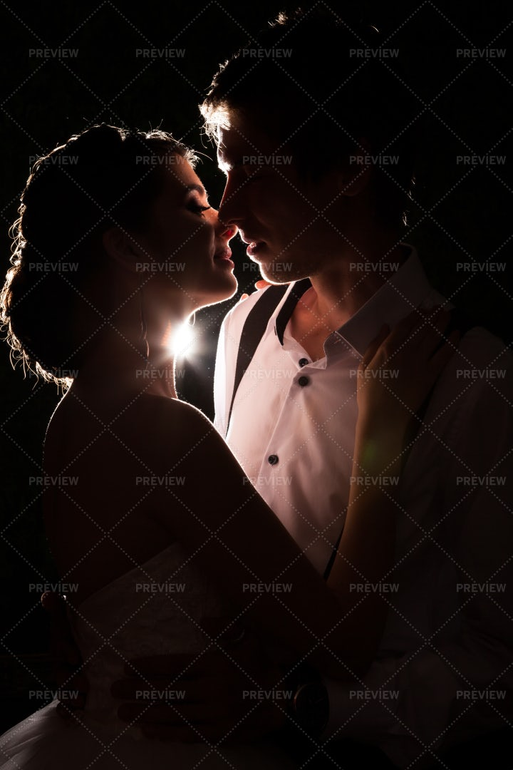 Back Lit Bride And Groom: Stock Photos