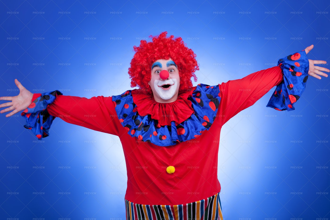 Clown On Blue Background: Stock Photos