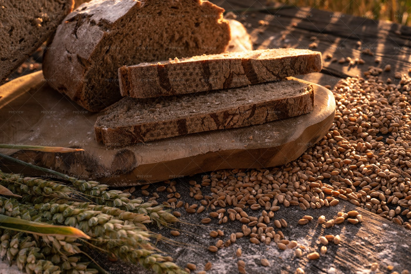 Bread Slices And Wheat In Summer Sun: Stock Photos