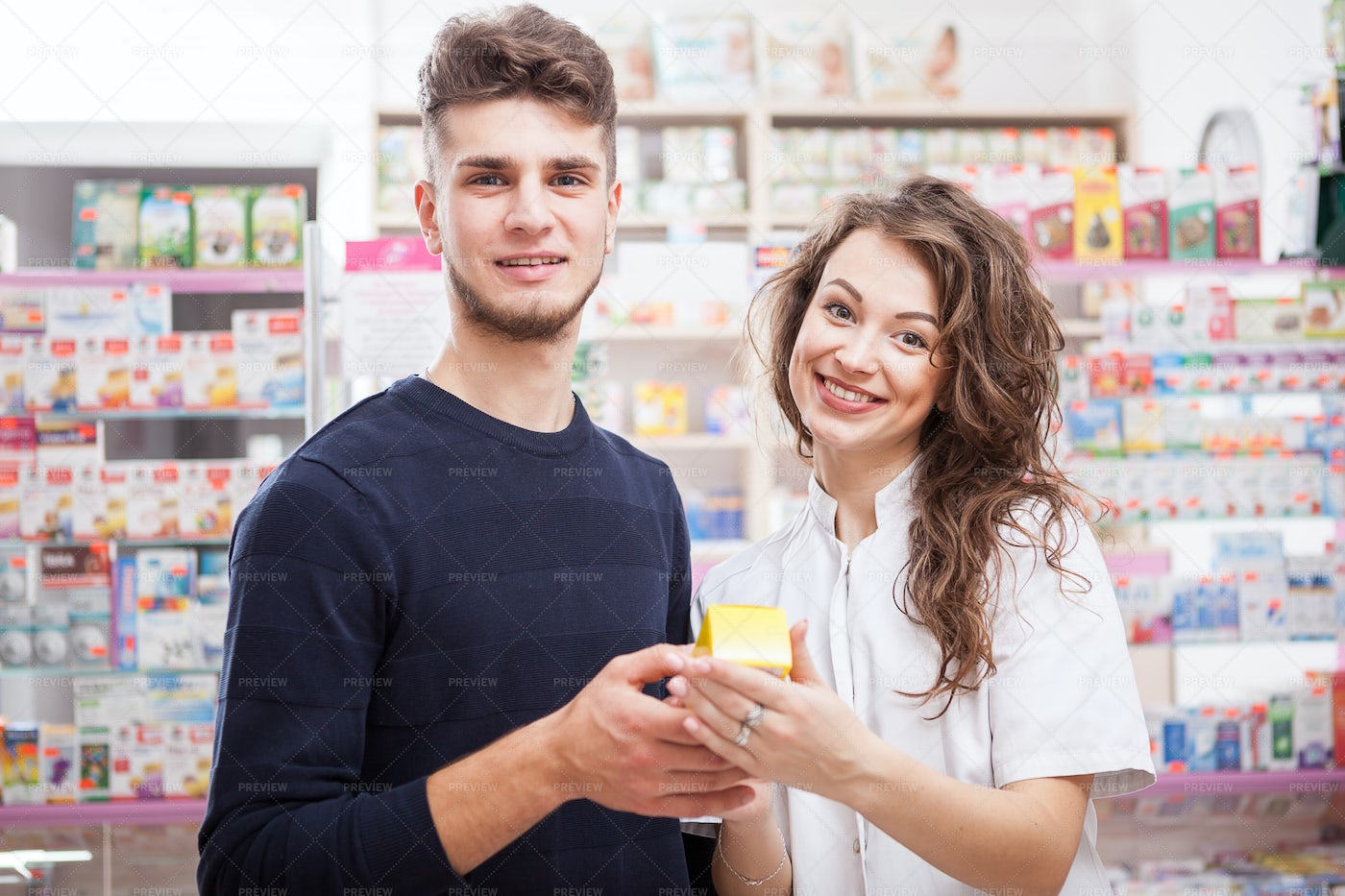 Portrait of Farmacist Doctor And Client: Stock Photos