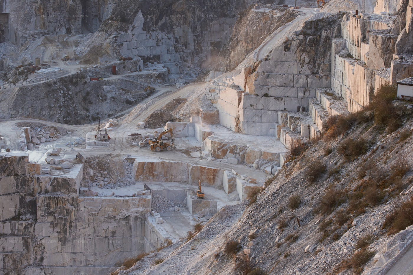 Heavy Machinery In Marble Quarry: Stock Photos