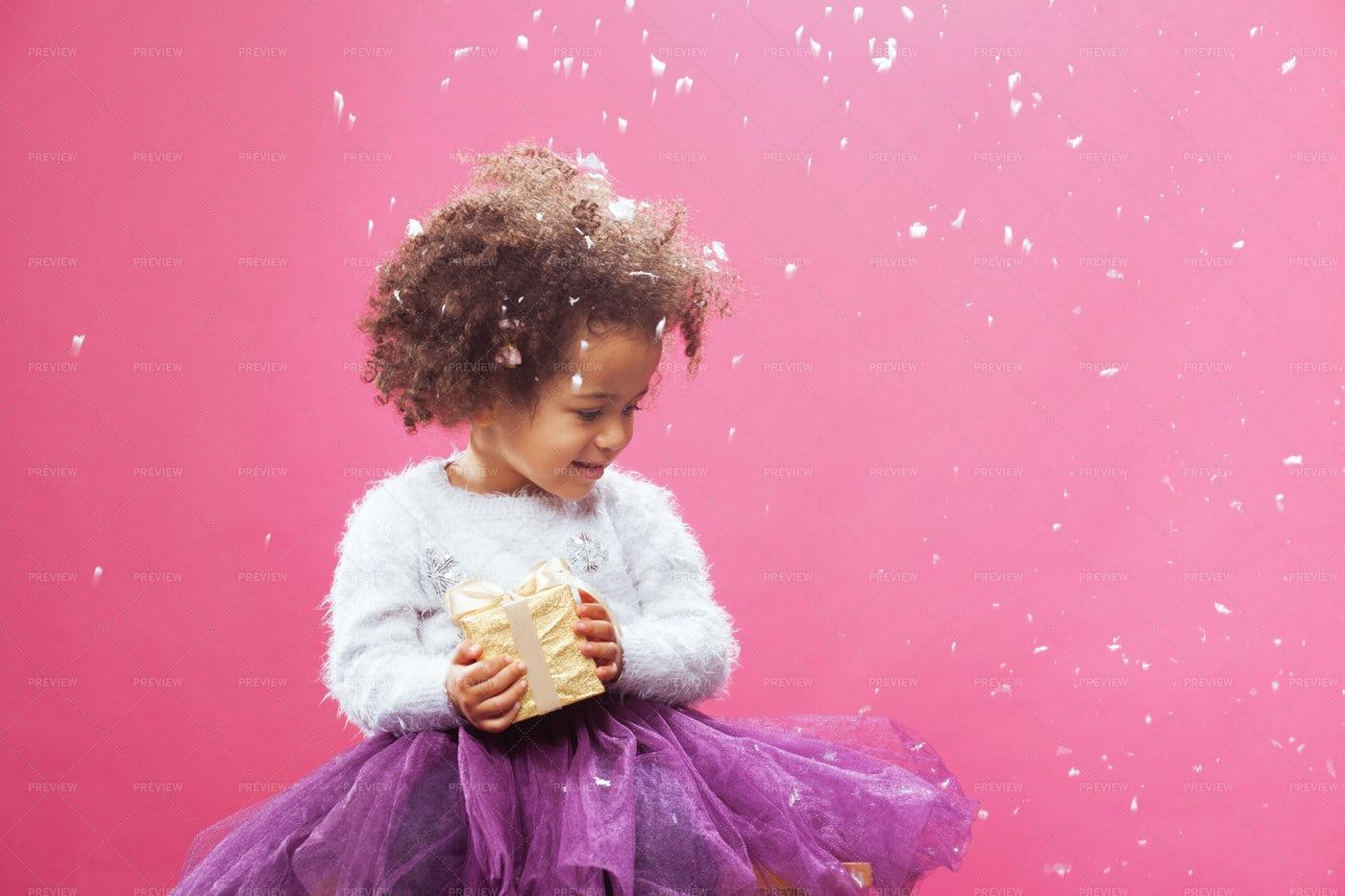 Girl Holding A Gift: Stock Photos