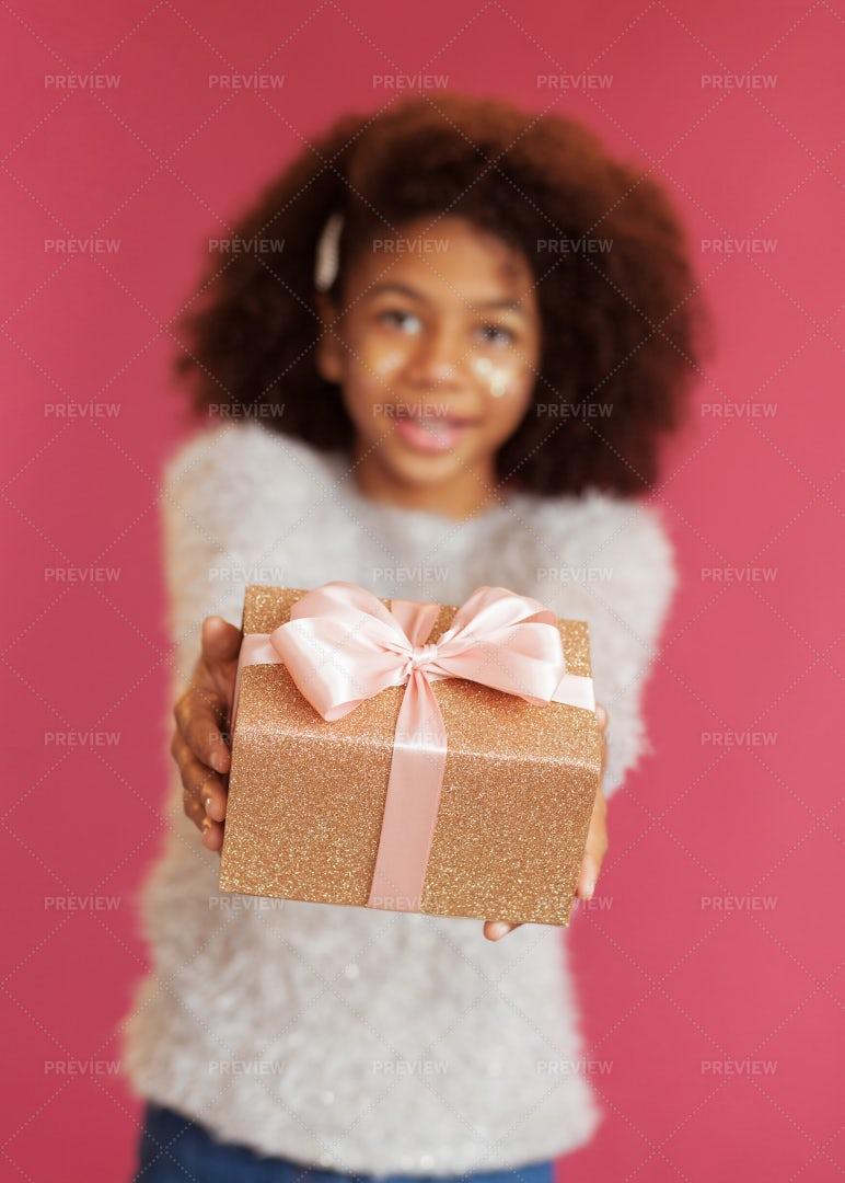 Girl Giving A Present: Stock Photos