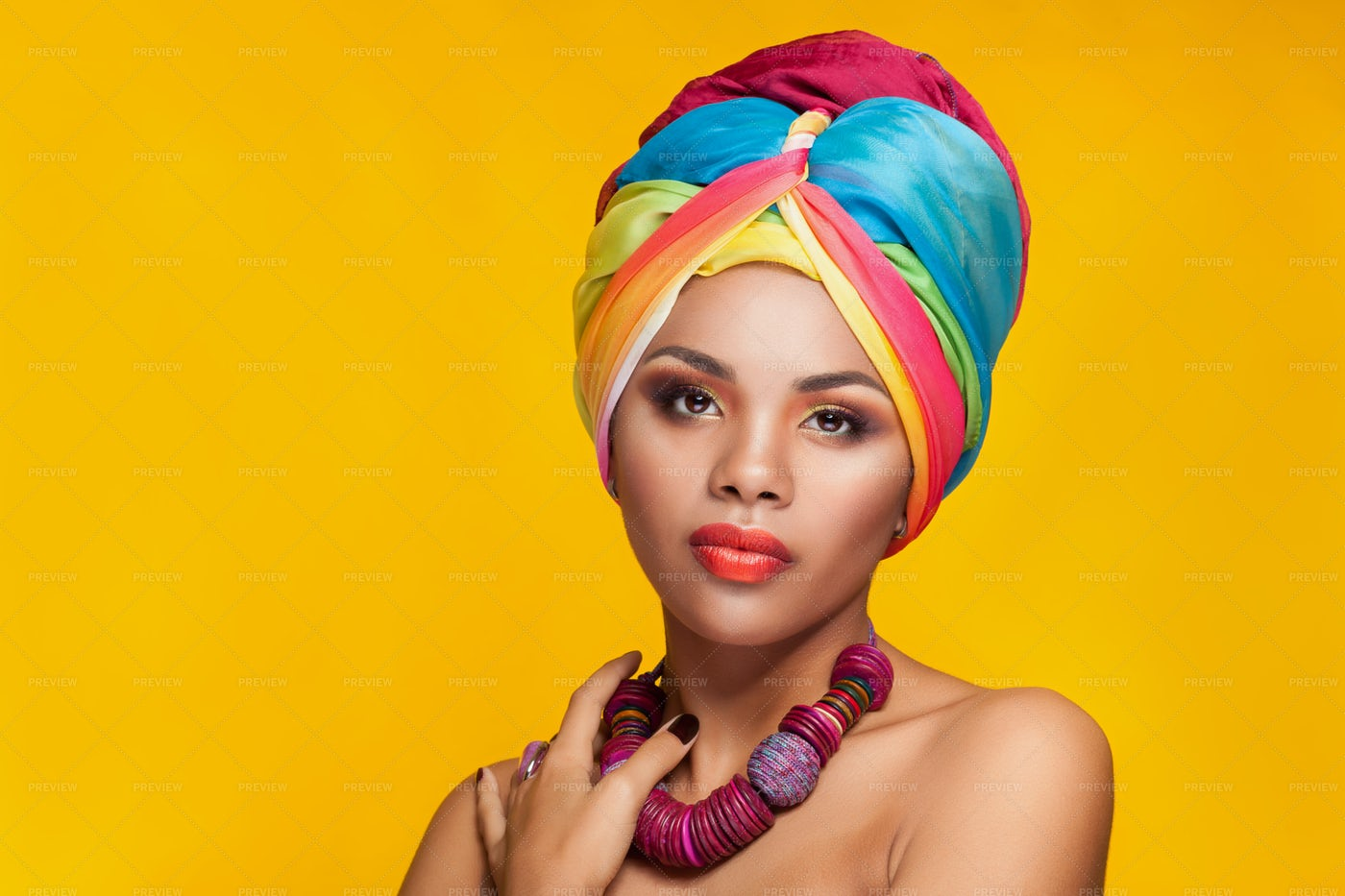 Headwrap And Colorful Jewelry: Stock Photos