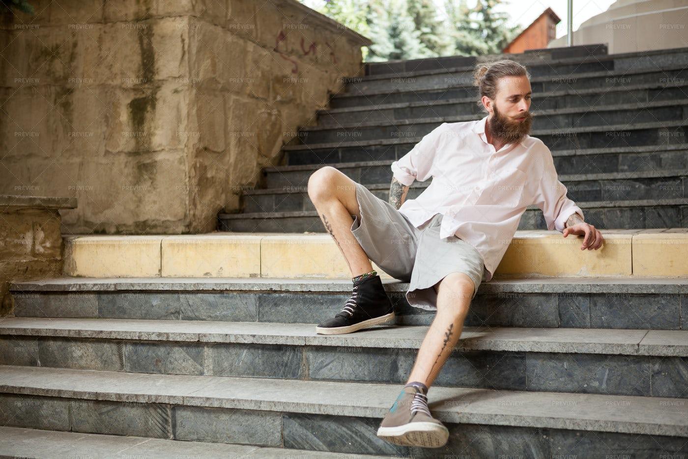 Man Sitting On Street Steps: Stock Photos