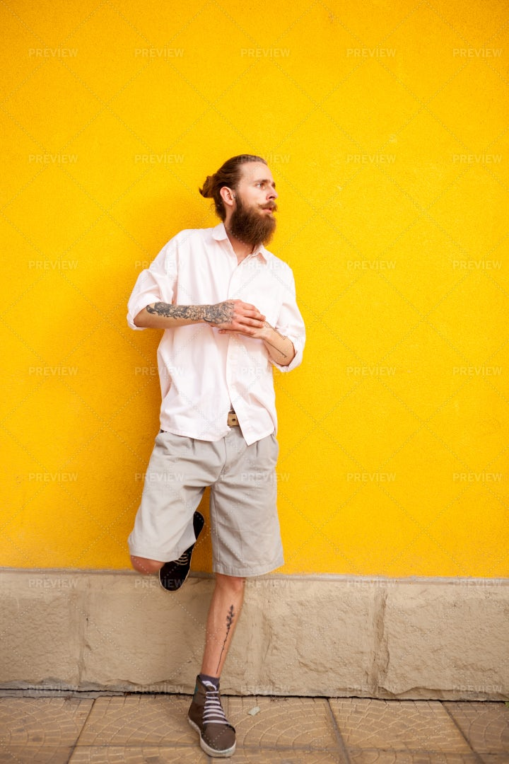 Hipster Against Yellow Wall: Stock Photos