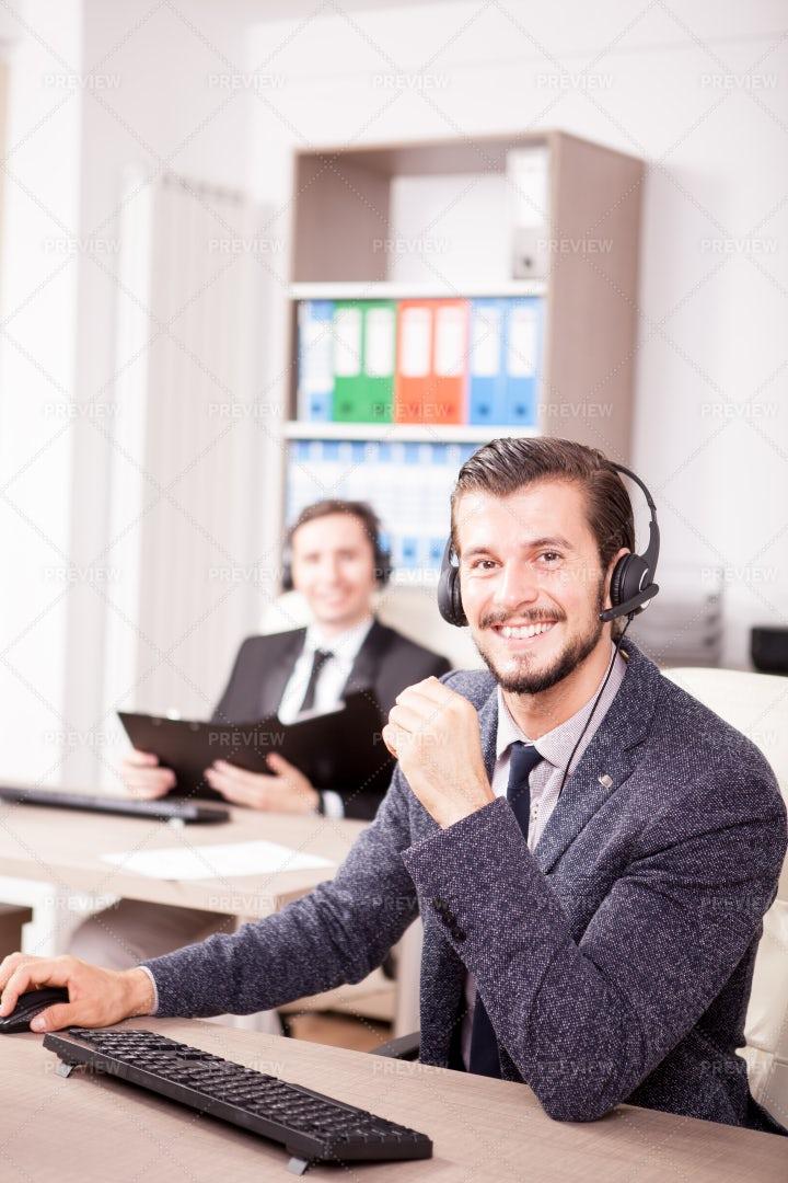 Smiling Man Working: Stock Photos