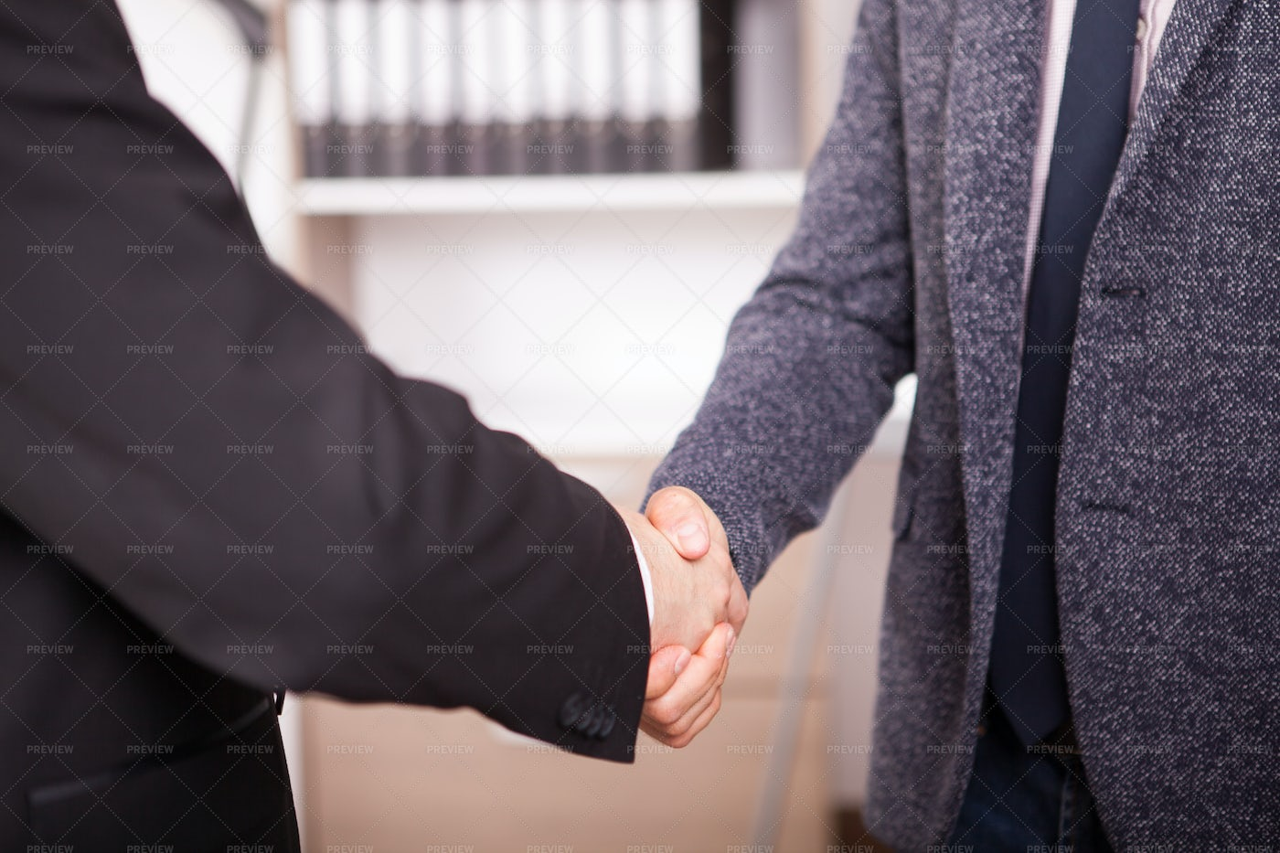 Shaking Hands In Corporate Office: Stock Photos