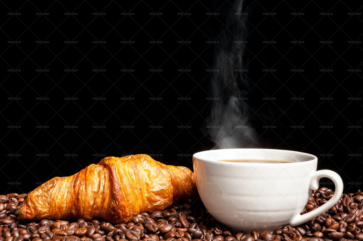 Croissant With Steaming Coffee: Stock Photos