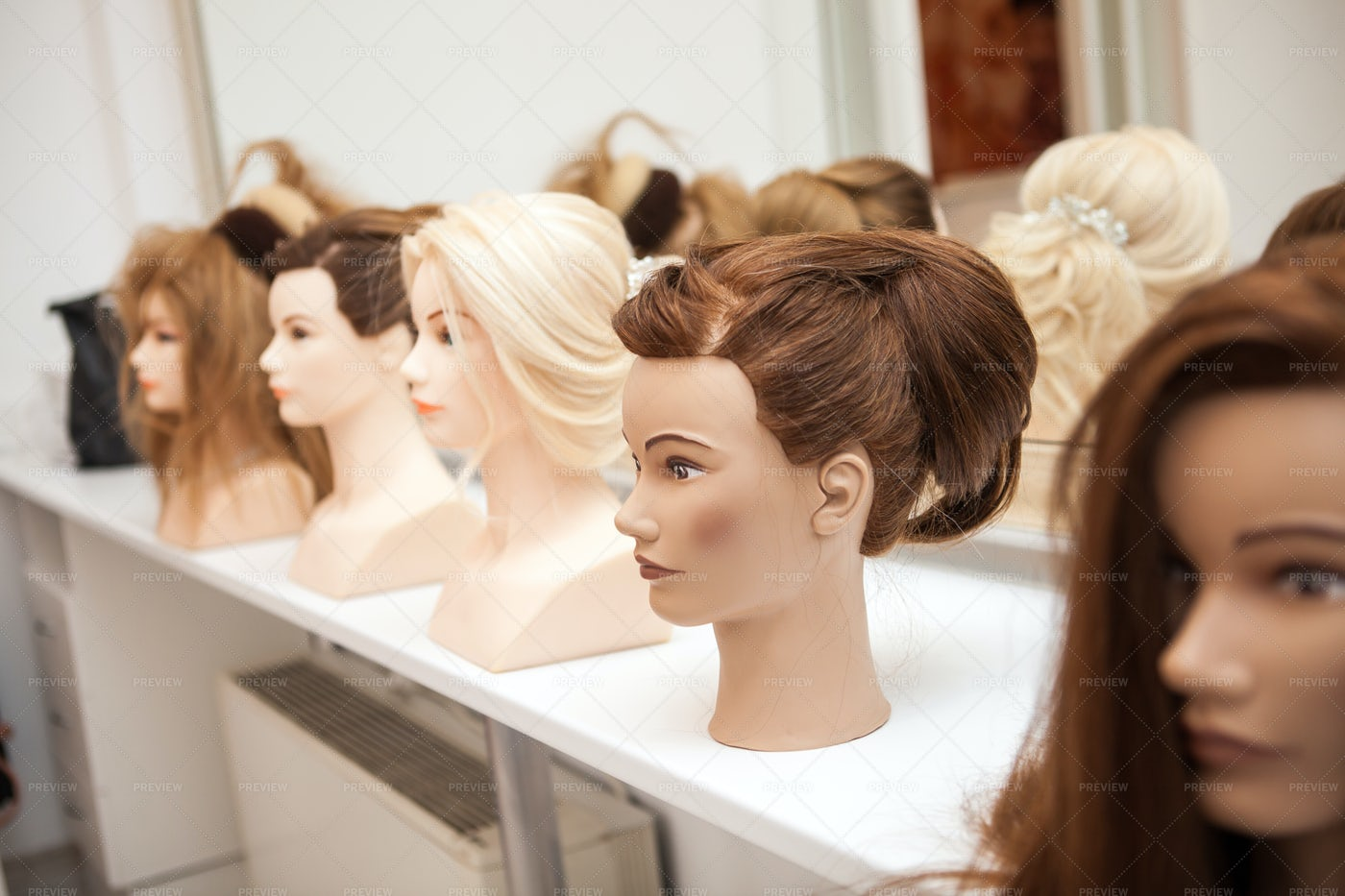 Cosmotology School Mannequins: Stock Photos